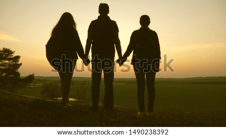 Woman, man and child travel, enjoy scenery at sunset. Freedom. Travelers family travel with backpacks. Happy family of tourists on vacation travel holding hands. Hiker Girl. Team work. #1490238392