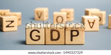 Wooden blocks with the word GDP ( Gross domestic product ). Financial measure of the market value of all the final goods and services produced in a specific time period. #1490337329