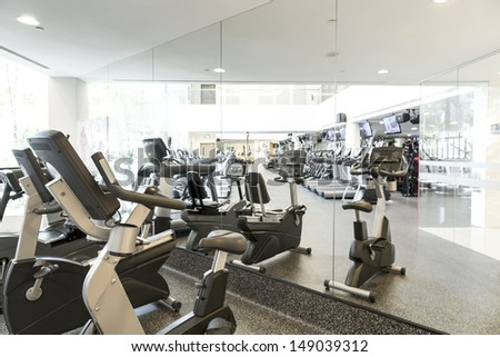 An interior shot of a club gym with all the execrise equipments #149039312