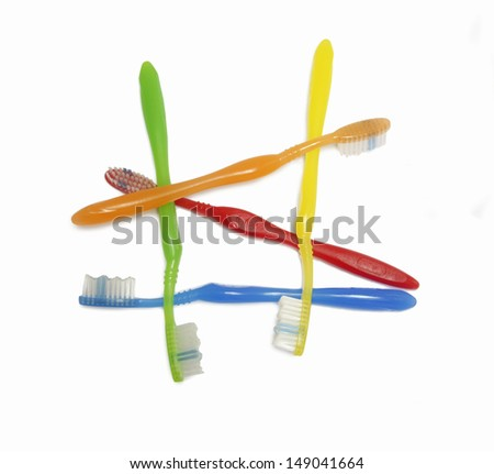 colorful toothbrush disheveled on withe background #149041664