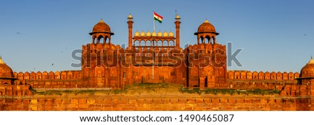 Red Fort is a historic fort UNESCO world Heritage Site at Delhi. On Independence day, the Prime Minister hoists Indian flag at main gate of fort & delivers nationally broadcast speech from its rampart #1490465087