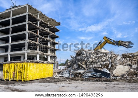 Building House Demolition site Excavator with hydraulic crasher machine and yellow container Royalty-Free Stock Photo #1490493296