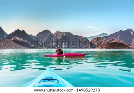 Young Man Kayaking in Hatta Dam best place for water adventure activities, Dubai Travel and tourism concept image #1490529278
