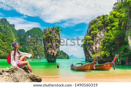 Traveler woman relaxing on beach joy nature scenic landscape James Bond Island Attraction famous landmark tourist travel Phuket Thailand summer holiday vacation trip Tourism beautiful destination Asia #1490560319