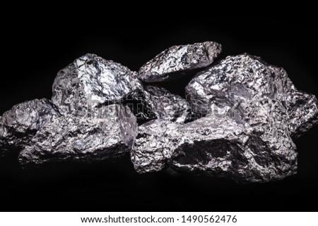 99.99% fine aluminum isolated on black background #1490562476