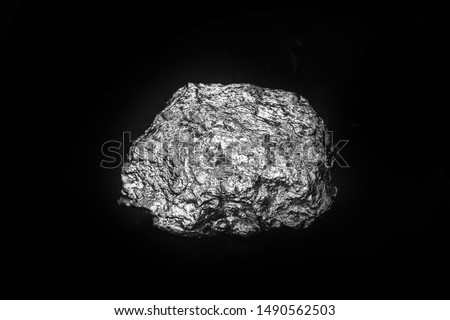 Aluminum stone on isolated black background. Aluminum is a chemical element, at room temperature it is solid, being the most abundant metallic element of the earth's crust. #1490562503