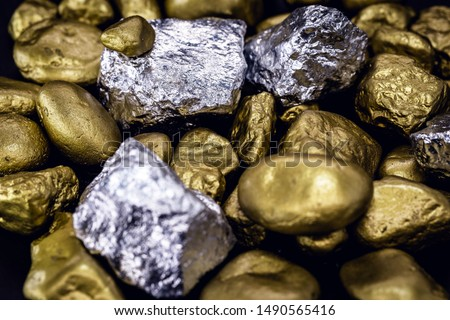 Gold and silver nuggets on black background. Precious stones, luxury concept and mineral drainage. Industrial activity, treasure and fortune. Royalty-Free Stock Photo #1490565416
