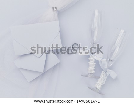 Gray wedding arrangement with champagne glasses #1490581691