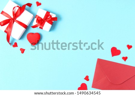 Gifts and hearts on a colored background top view. Love. Valentine's day background with place for text insertion.  #1490634545