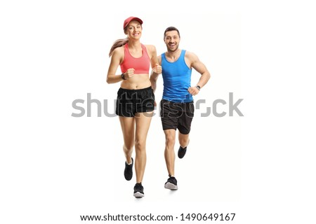 Full length portrait of a young man and woman jogging isolated on white background #1490649167