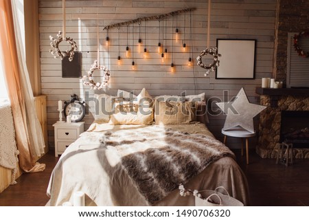 Cosy bedroom with eco decor. Wood and nature concept in interior of room. Scandinavian interior, real photo. Hygge decoration. #1490706320