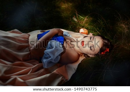 Fairy tale princess with poisoned apple in the magic wood