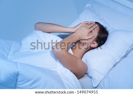 Depressed women in bed. Top view of young sad women lying on the sofa and hiding her face in hands #149074955