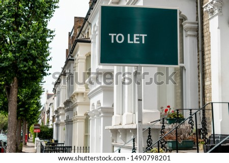 An estate agency 'To Let' sign board