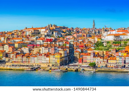 View of downtown Porto (Oporto), Portugal. Cityscape of the second-largest Portuguese city. (There are some cables of a cable road in the foreground) #1490844734