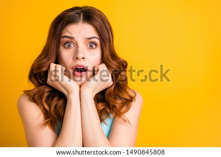 Close up copyspace photo of terrified frightened girlfriend seeing something frightful student feared with upcoming exams wearing turquoise tank-top while isolated over yellow bright color background #1490845808