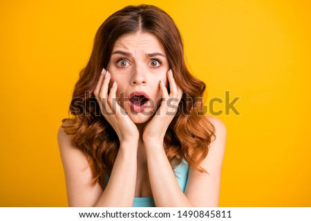 Close up photo of horrified frightened girlfriend feared with something being about to cry and shout wearing turquoise singlet while isolated with vibrant yellow color background #1490845811