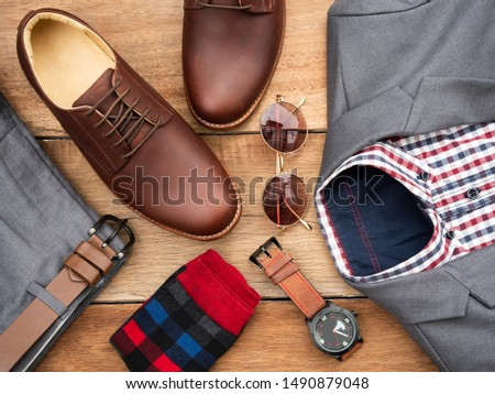 Men fashion casual clothing set and accessories isolated on wooden background include derby shoes, gray suit, pants, belt, sunglass, sock and scottis office shirt. Flat lay, top view #1490879048