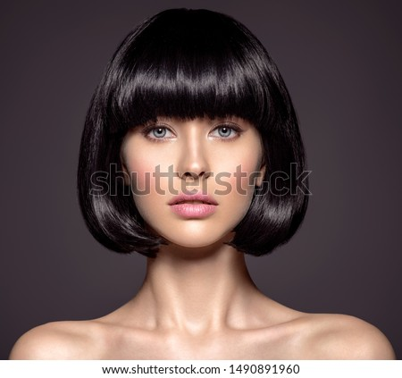 Woman with beauty short black hair - posing at studio. Fashion model with  straight hair. Fashion model at studio. Beautiful woman with a style  hairstyle. Closeup portrait of a fashion model. #1490891960