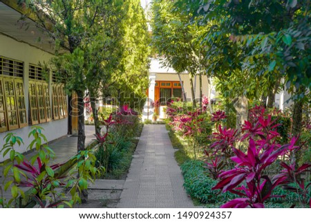 Hotel Garden with flowers and block #1490924357