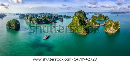 Aerial view Vung Vieng floating fishing village and rock island, Halong Bay, Vietnam, Southeast Asia. UNESCO World Heritage Site. Junk boat cruise to Ha Long Bay. Famous destination of Vietnam Royalty-Free Stock Photo #1490942729