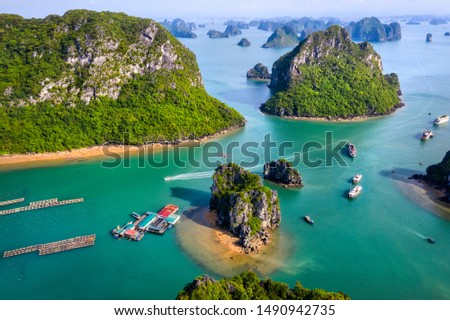 Aerial view Vung Vieng floating fishing village and rock island, Halong Bay, Vietnam, Southeast Asia. UNESCO World Heritage Site. Junk boat cruise to Ha Long Bay. Famous destination of Vietnam Royalty-Free Stock Photo #1490942735