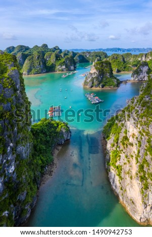 Aerial view Vung Vieng floating fishing village and rock island, Halong Bay, Vietnam, Southeast Asia. UNESCO World Heritage Site. Junk boat cruise to Ha Long Bay. Famous destination of Vietnam Royalty-Free Stock Photo #1490942753