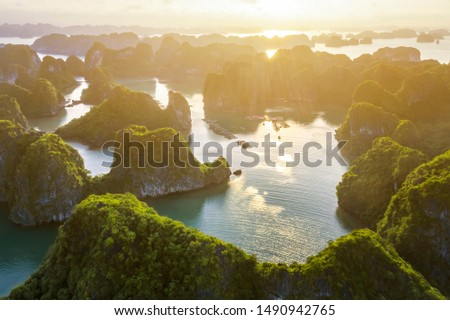 Aerial view Vung Vieng floating fishing village and rock island, Halong Bay, Vietnam, Southeast Asia. UNESCO World Heritage Site. Junk boat cruise to Ha Long Bay. Famous destination of Vietnam Royalty-Free Stock Photo #1490942765