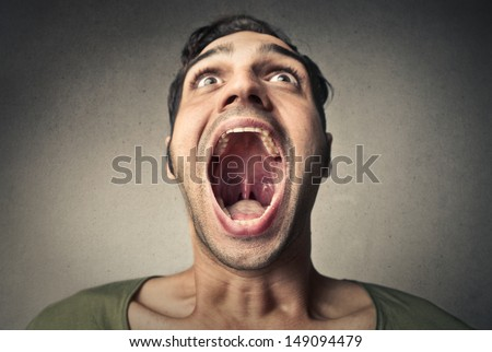 boy screams opening the mouth Royalty-Free Stock Photo #149094479