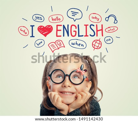 Beautiful cute little girl with eyeglasses looking at i love english word, illustrations and words above her head.  i love english concept. #1491142430