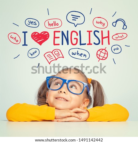 Beautiful cute little girl with eyeglasses looking at the illustrations and words in english above her head. I love english concept. Royalty-Free Stock Photo #1491142442
