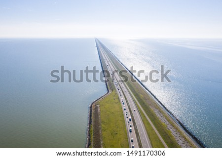 Afsluitdijk, a major dam and causeway in the Netherlands, runs from Den Oever in North Holland to village of Zurich in Friesland province, damming off the Zuiderzee, salt water inlet of the North Sea. #1491170306