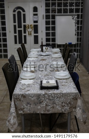 View of a table set up for a formal dinner with no people and no food #1491179576