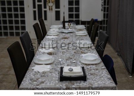 View of a table set up for a formal dinner with no people and no food #1491179579