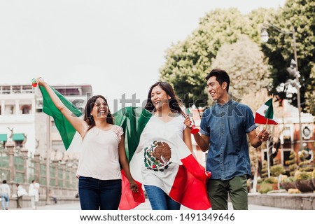mexican guys cheering Viva Mexico on independence day in Mexico city Royalty-Free Stock Photo #1491349646