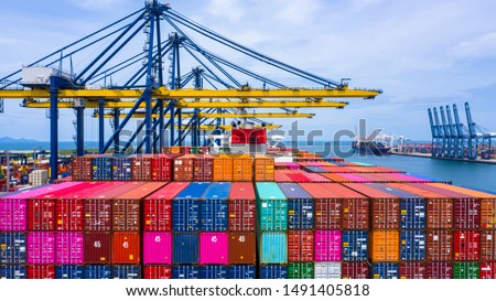 Container ship loading and unloading in sea port, Aerial view of business logistic import and export freight  transportation by container ship in harbor, Container loading Cargo freight ship, Dubai. #1491405818