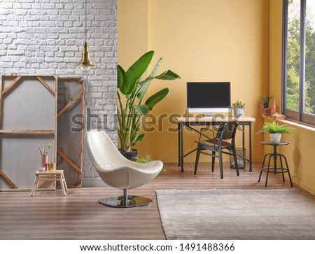 White brick wall and yellow background interior style, working table and easel painting decor. Home decoration. #1491488366