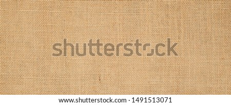 Hessian sackcloth burlap woven texture background  / cotton woven fabric background with flecks of varying colors of beige and brown. with copy space. office desk concept. #1491513071