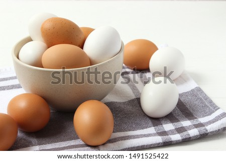 chicken eggs on the table. Farm products, natural eggs.  #1491525422