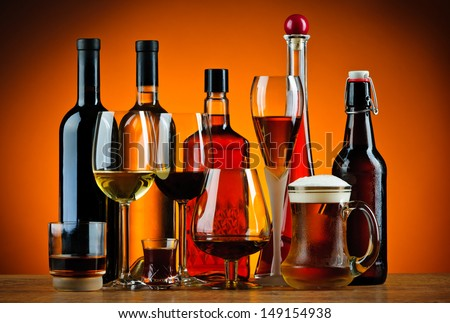 still life with various glasses and bottles of alcohol #149154938