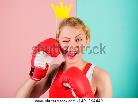 Woman boxing glove and crown symbol of princess. Queen of sport. Feminine tender blonde with queen crown wear boxing gloves. Fight for success. VIP gym. Fighting queen. Become best in boxing sport. #1491564449
