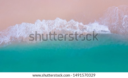 Beach top view or aerial view of wave foam from water splashing on the sand beach. Wave action, fluid dynamics. #1491570329