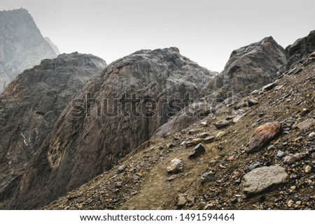 A sloping slope covered with loose stones. Difficult climb to Aktru. Beautiful views of the rounded mountains on a tour of the nature of Altai land. High  pyramidal mountain. Siberia. Russia. #1491594464