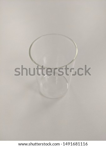 Empty Glass on White Table isolated #1491681116