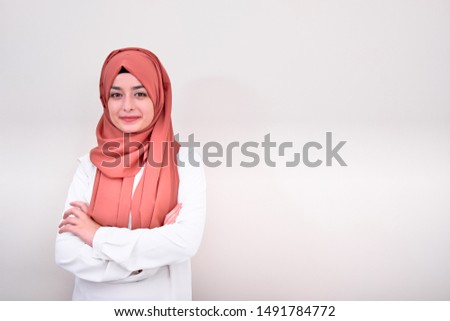Muslim woman folded arms with isolated white background, hijab muslim teacher or doctor girl folded arms #1491784772