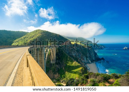 Bixby Creek Bridge on Highway (Highway 1) at the US West Coast traveling south to Los Angeles, Big Sur Area Royalty-Free Stock Photo #1491819050