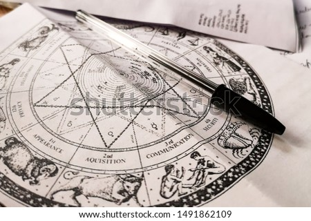 Mystical astral chart on table Royalty-Free Stock Photo #1491862109