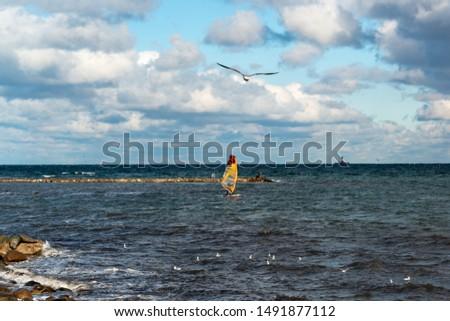Kiel, Germany, October 28, 2018 - Windsurfers in Kiel Bay in autumn in strong winds #1491877112
