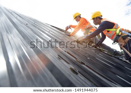 Technician is Work Roof Repair Construction engineer wear safety uniform inspection metal roofing work for roof  #1491944075