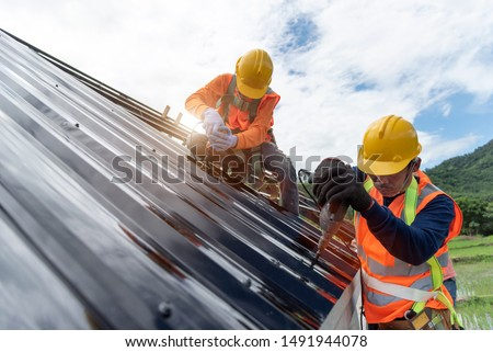 Technician is Work Roof Repair Construction engineer wear safety uniform inspection metal roofing work for roof  #1491944078